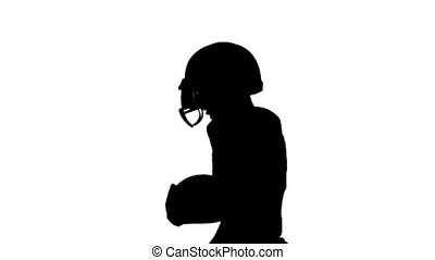Athlete runs with the ball in a protective helmet. Silhouette. White background. Slow motion