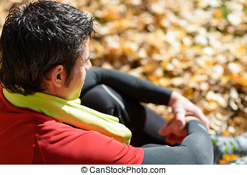 Athlete sitting and resting