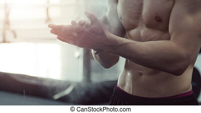 Athlete Sprinkles Hands with Talc Powder - Croped view of...