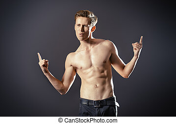 athlete student - Handsome shirtless male model posing at...