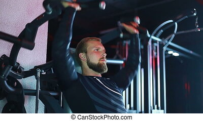 Athlete swinging on the simulator.