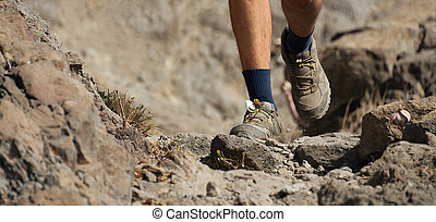 Athlete trail running in the mountains