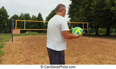 Athlete with colored volleyball ball