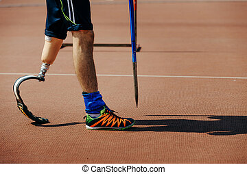 athlete with limb loss leg javelin throw in track and field...