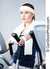 Athlete woman training on training apparatus