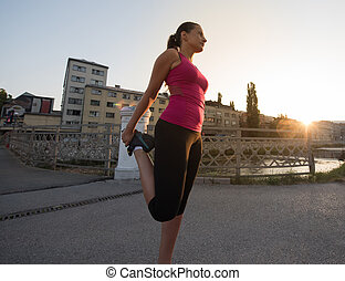 athlete woman warming up and stretching