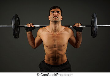 Athlete young  man exercises