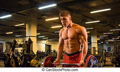 Athlete young man with barbell doing exercise