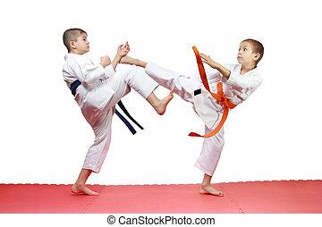 Athletes are beating blows kicks
