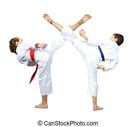 On a white background athletes are beating kick leg