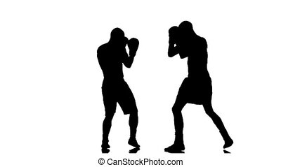 Athletes boxers sparring in the studio. Silhouette in slow motion