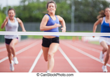 Athletes close to finish line - Female athletes close to...