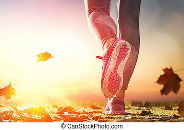 athlete's foots close-up on autumn walk in nature outdoors....