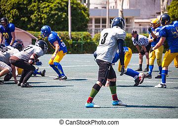 athletes in american football stadium