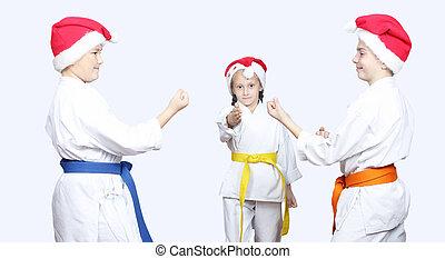 Athletes in caps of Santa Claus