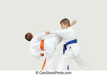 Athletes perform blows karate