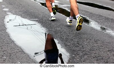 Athletes run on wet asphalt  at XXX Moscow International Peace Marathon