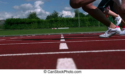 Athletes running a race on the track