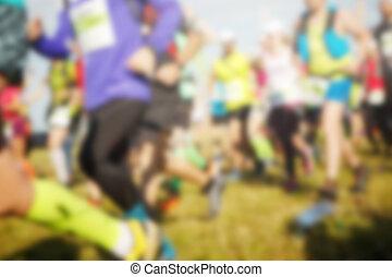 Athletes running on green grass