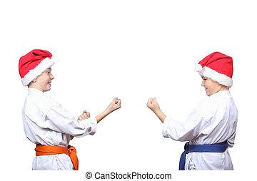 Athletes standing in rack of karate