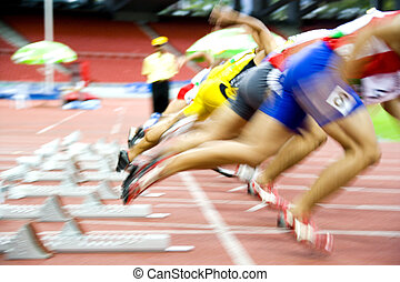Athletes Starting - Image of 100 meters athletes at the...