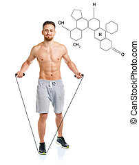Athletic attractive man jumping with the chemical formula on background - concept of healthy life