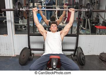 Athletic bodybuilder in the gym