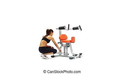 Athletic brunette on isodynamic exerciser