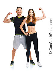 Athletic couple - man and woman after fitness exercise on the wh