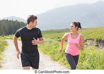 Athletic couple on a jog