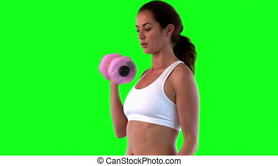 Athletic female exercising with dumbells