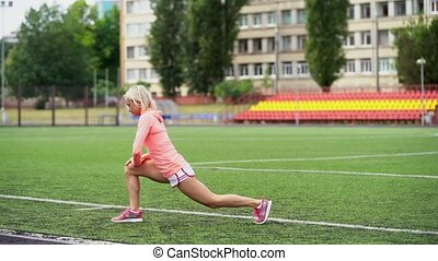 Athletic fit Caucasian woman warming up for jog