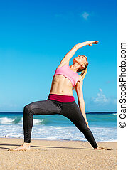 Athletic Fitness Woman Stretching At the Beach,