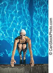 Athletic girl in the swim pool