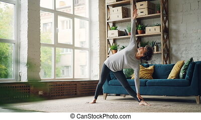 Athletic girl is doing sequence of strength and stretching...