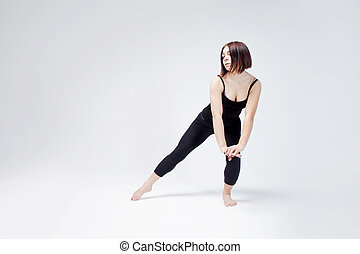 athletic girl posing in Studio, place for your text on the right