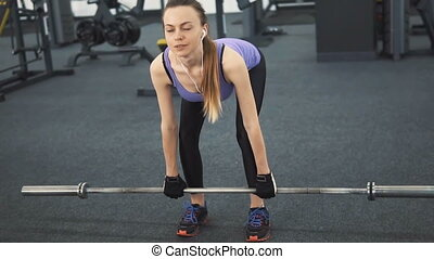 Athletic Girl Trains Back - Athletic caucasian girl, in...