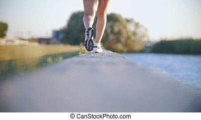 Athletic Girl Walking Near The River In Sneakers, Slow...