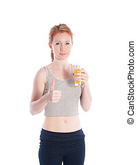 Athletic girl with a glass of juice and a thumbs up on a white background.