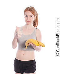 Athletic girl with bananas in hand on white background.