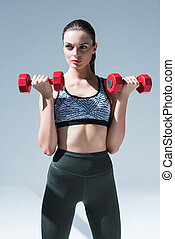 athletic girl with dumbbells