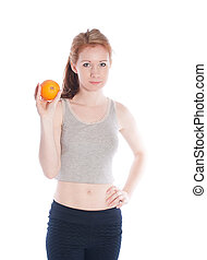 Athletic girl with orange in hands on a white background.