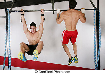 athletic group executing exercise tightening on horizontal...