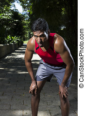 Athletic Indian man having a break from running