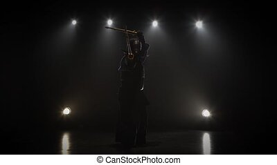 Athletic Kendo master practicing martial art with the shinai...
