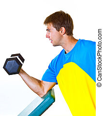 Athletic Man Lifting Weights in the Gym