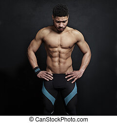 Athletic man on black wall background - Athletic black man ...