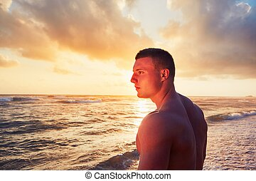Athletic man on the tropical beach