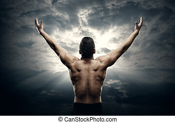 Athletic Man Open Arms on Sunrise Sky, Muscular Athlete Body Back Rear View over Sunset Background
