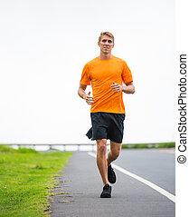 Athletic man running jogging outside